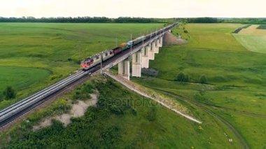 depositphotos_178273394-stock-video-a-freight-train-crosses-a