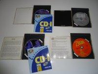 [ESTIM] Collection CDI avec CDI 470 neuf en boîte, les deux Zelda FR, le pistolet sous blister, environ 70 jeux... Mini_210511030042977864